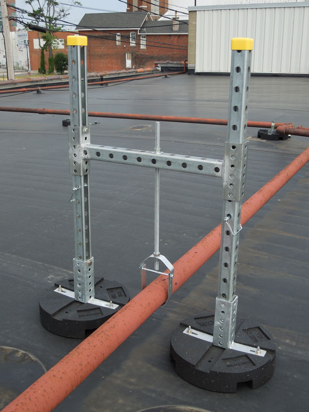 h-stand with clevis hanger supporting rooftop pipes