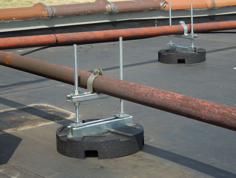 installed puc bases with elevated pipe supports